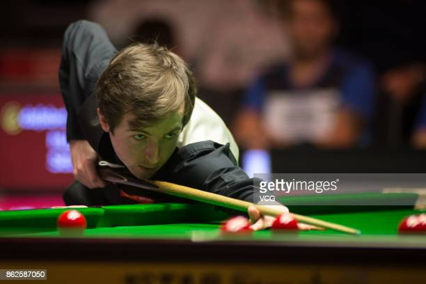 Scott Donaldson of Scotland plays a shot during his first round match against Mark Selby of England on day two of 2017 Dafabet English Open at...