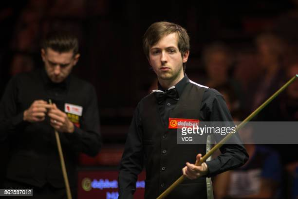 Scott Donaldson of Scotland reacts during his first round match against Mark Selby of England on day two of 2017 Dafabet English Open at Barnsley...