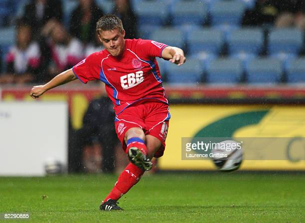 Scott Donnelly of Aldershot Town scores the equaliser during the Carling Cup Round One match between Coventry City and Aldershot Town at the Ricoh...