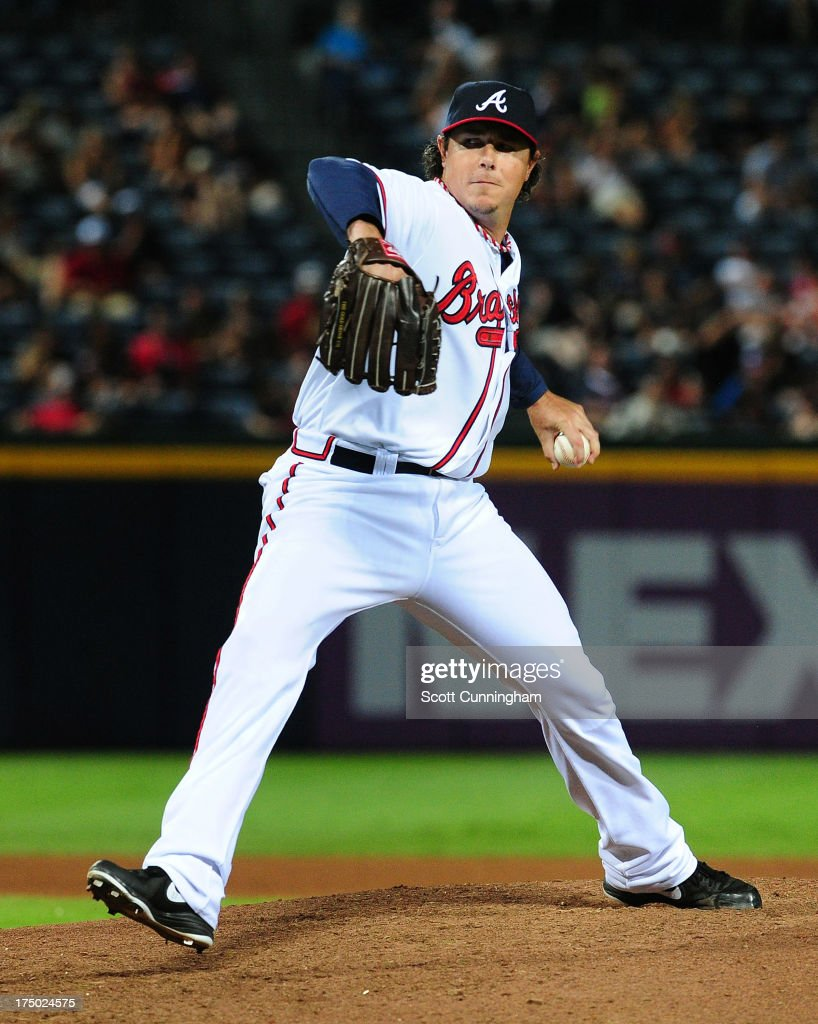 <a gi-track='captionPersonalityLinkClicked' href=/galleries/search?phrase=Scott+Downs&family=editorial&specificpeople=240337 ng-click='$event.stopPropagation()'>Scott Downs</a> #32 of the Atlanta Braves pitches against the Colorado Rockies at Turner Field on July 29, 2013 in Atlanta, Georgia.