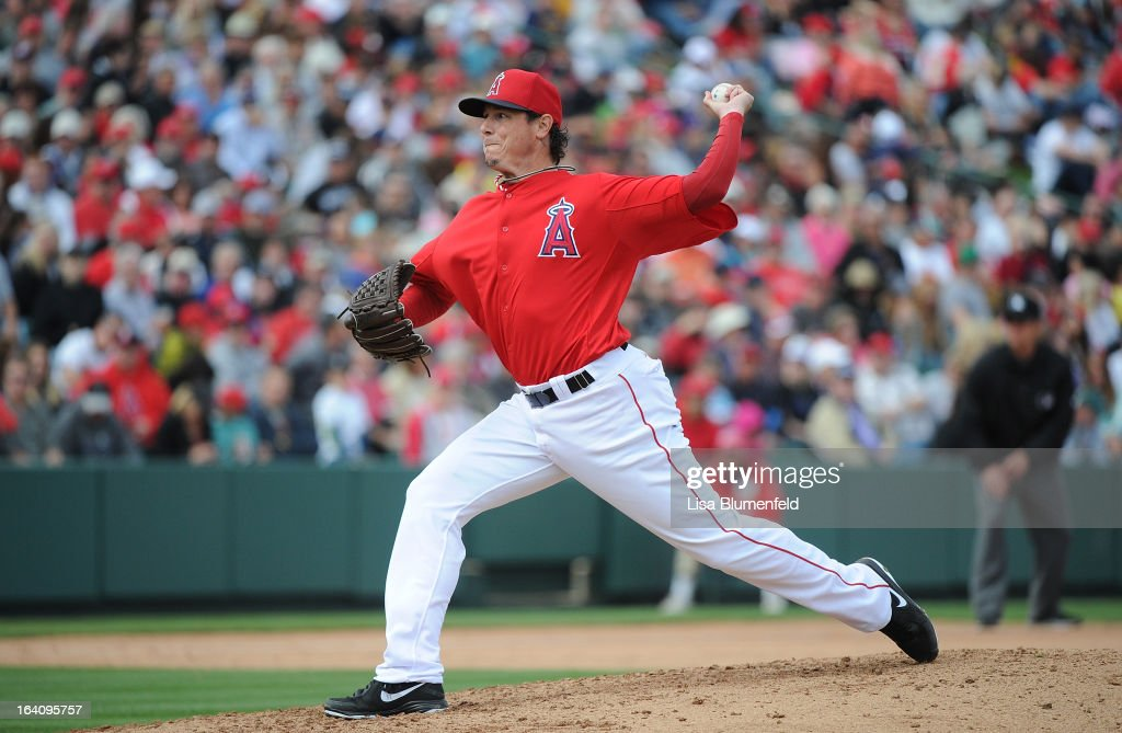 <a gi-track='captionPersonalityLinkClicked' href=/galleries/search?phrase=Scott+Downs&family=editorial&specificpeople=240337 ng-click='$event.stopPropagation()'>Scott Downs</a> #37 of the Los Angeles Angels of Anaheim pitches against the Colorado Rockies at Tempe Diablo Stadium on March 9, 2013 in Peoria, Arizona.
