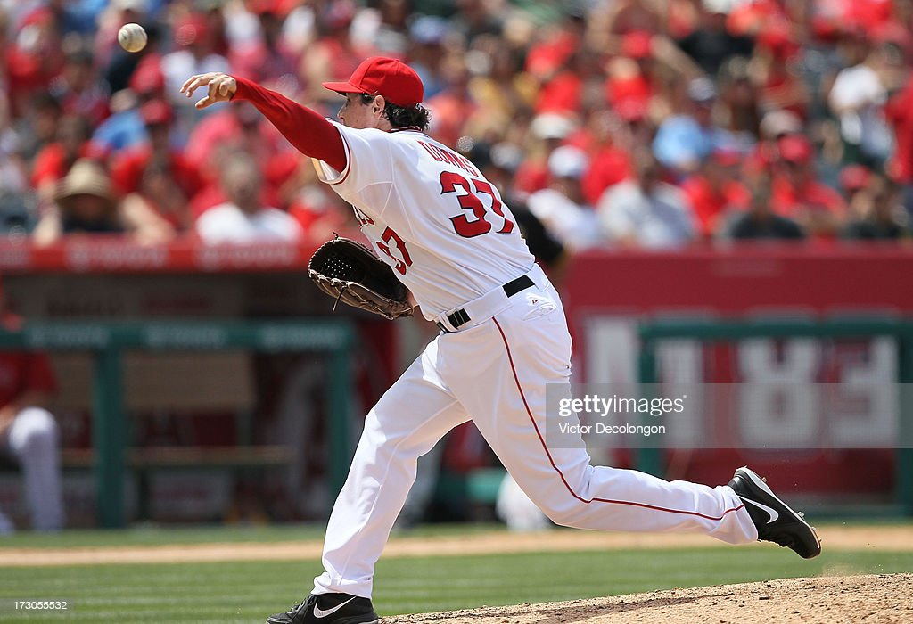 <a gi-track='captionPersonalityLinkClicked' href=/galleries/search?phrase=Scott+Downs&family=editorial&specificpeople=240337 ng-click='$event.stopPropagation()'>Scott Downs</a> #37 of the Los Angeles Angels of Anaheim pitches against the Pittsburgh Pirates during the MLB game at Angel Stadium of Anaheim on June 23, 2013 in Anaheim, California. The Pirates defeated the Angels 10-9 in ten innings.