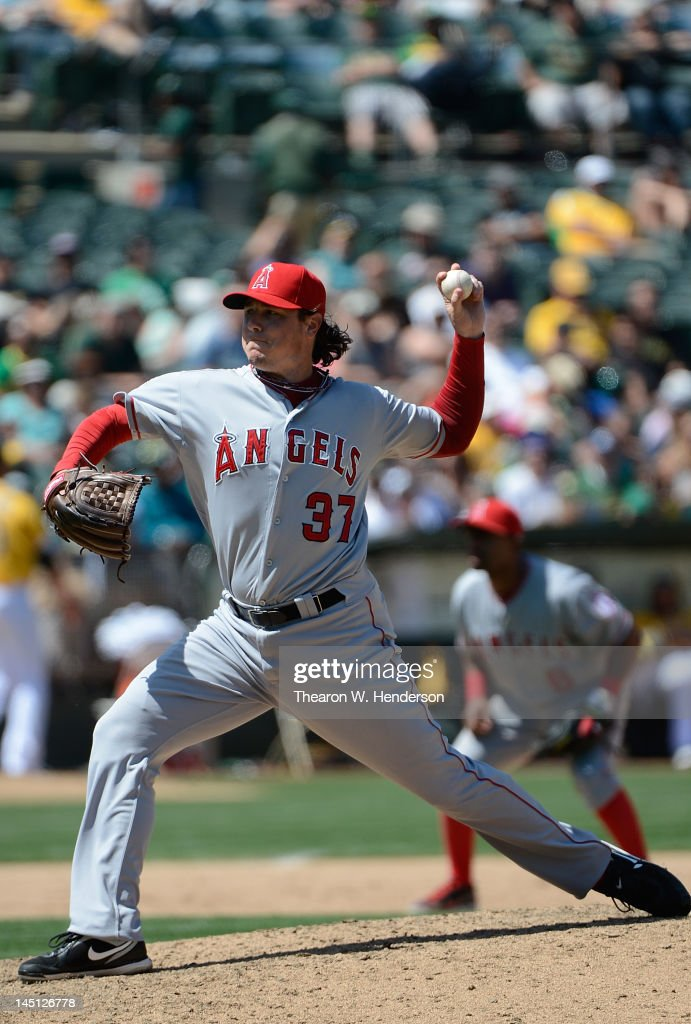 <a gi-track='captionPersonalityLinkClicked' href=/galleries/search?phrase=Scott+Downs&family=editorial&specificpeople=240337 ng-click='$event.stopPropagation()'>Scott Downs</a> #37 of the Los Angeles Angels of Anaheim pitches in the ninth inning against the Oakland Athletics at O.co Coliseum on May 23, 2012 in Oakland, California. The Angels won the game in eleven innings 3-1.
