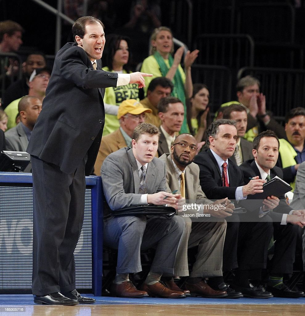Scott Drew, head coach of the Baylor Bears calls out a play during his team's game against the Brigham Young Cougars in the second half during the 2013 NIT Championship - Semifinals at the Madison Square Garden on April 2, 2013 in New York City.