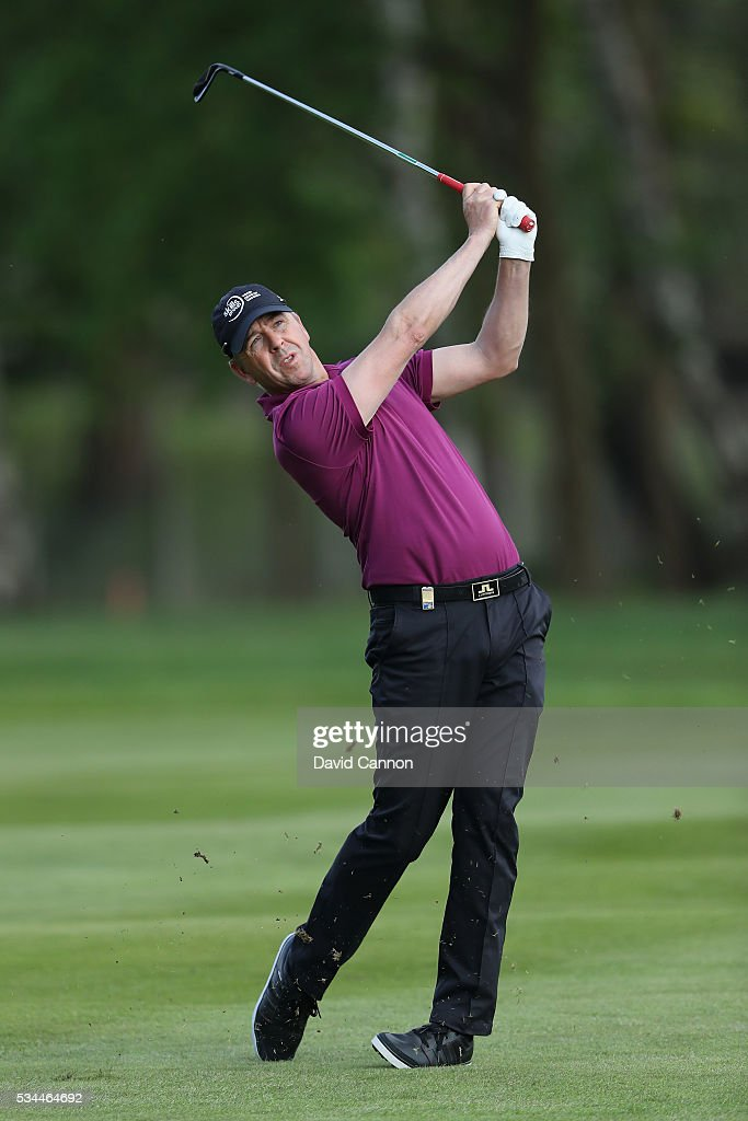 <a gi-track='captionPersonalityLinkClicked' href=/galleries/search?phrase=Scott+Drummond&family=editorial&specificpeople=206228 ng-click='$event.stopPropagation()'>Scott Drummond</a> of Scotland plays his second shot on the 9th hole during day one of the BMW PGA Championship at Wentworth on May 26, 2016 in Virginia Water, England.