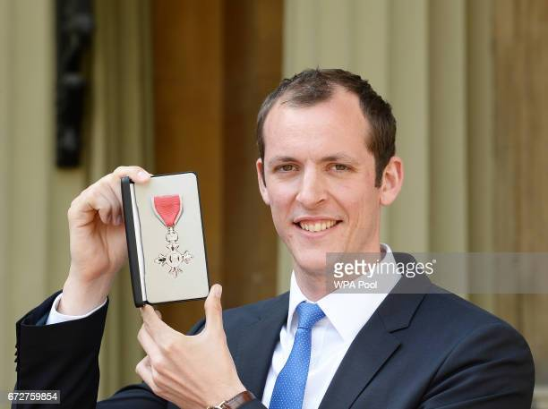 Scott Durant poses after he was awarded an MBE for services to rowing by the Princess Royal during an Investiture ceremony at Buckingham Palace on...