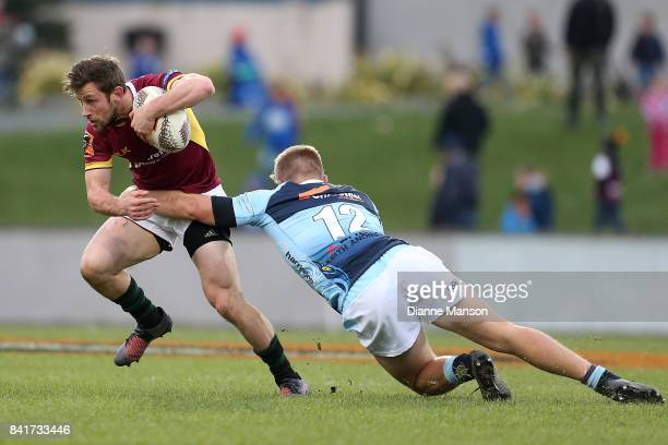 Scott Eade of Southland is tackled by Jack Goodhue of Northland during the round three Mitre 10 Cup match between Southland and Northland at Rugby...
