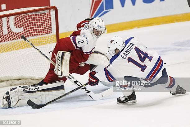 Scott Eansor of USA scores the 50 goal past Czech goalkeeper Ales Stezka during the 2016 IIHF World Junior Ice Hockey Championship quarterfinal match...