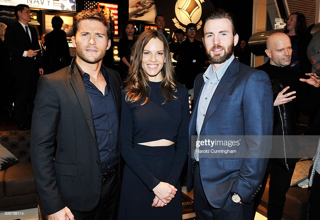 Scott Eastwood, Hilary Swank and Chris Evans visit the IWC booth during the launch of the Pilot's Watches Novelties from the Swiss luxury watch manufacturer IWC Schaffhausen at the Salon International de la Haute Horlogerie (SIHH) 2016 on January 19, 2016 in Geneva, Switzerland.