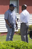 Scott family's lawyer L Chris Stewart speaks with Rodney Scott the brother of Walter Scott outside the Scott family home in Charleston South Carolina...