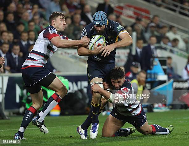 Scott Fardy of the Brumbies is challenged by his opponents during the round 12 Super Rugby match between the Rebels and the Brumbies at AAMI Park on...