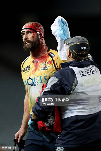 Scott Fardy of the Brumbies is injured with a cut to his head during the round 16 Super Rugby match between the Blues and the Brumbies at Eden Park...
