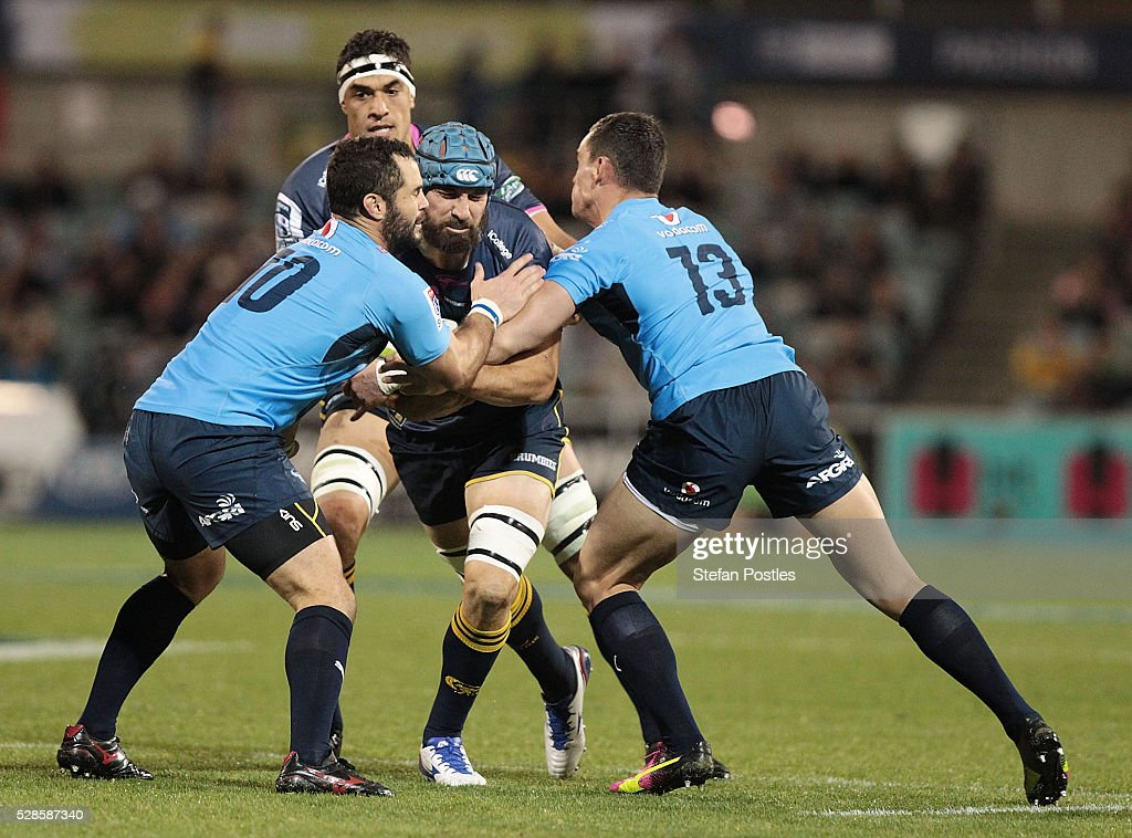<a gi-track='captionPersonalityLinkClicked' href=/galleries/search?phrase=Scott+Fardy&family=editorial&specificpeople=4500470 ng-click='$event.stopPropagation()'>Scott Fardy</a> of the Brumbies is tackled during the round 11 Super Rugby match between the Brumbies and the Bulls at GIO Stadium on May 6, 2016 in Canberra, Australia.