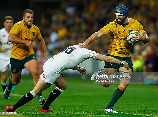 Scott Fardy of the Wallabies is tackled during the International Test match between the Australian Wallabies and England at AAMI Park on June 18 2016...