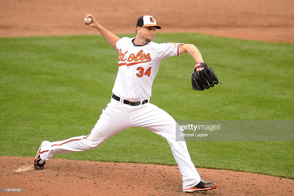 <a gi-track='captionPersonalityLinkClicked' href=/galleries/search?phrase=Scott+Feldman&family=editorial&specificpeople=540379 ng-click='$event.stopPropagation()'>Scott Feldman</a> #34 of the Baltimore Orioles pitches during a baseball game against the Colorado Rockies on August 18, 2013 at Oriole Park at Camden Yards in Baltimore, Maryland.