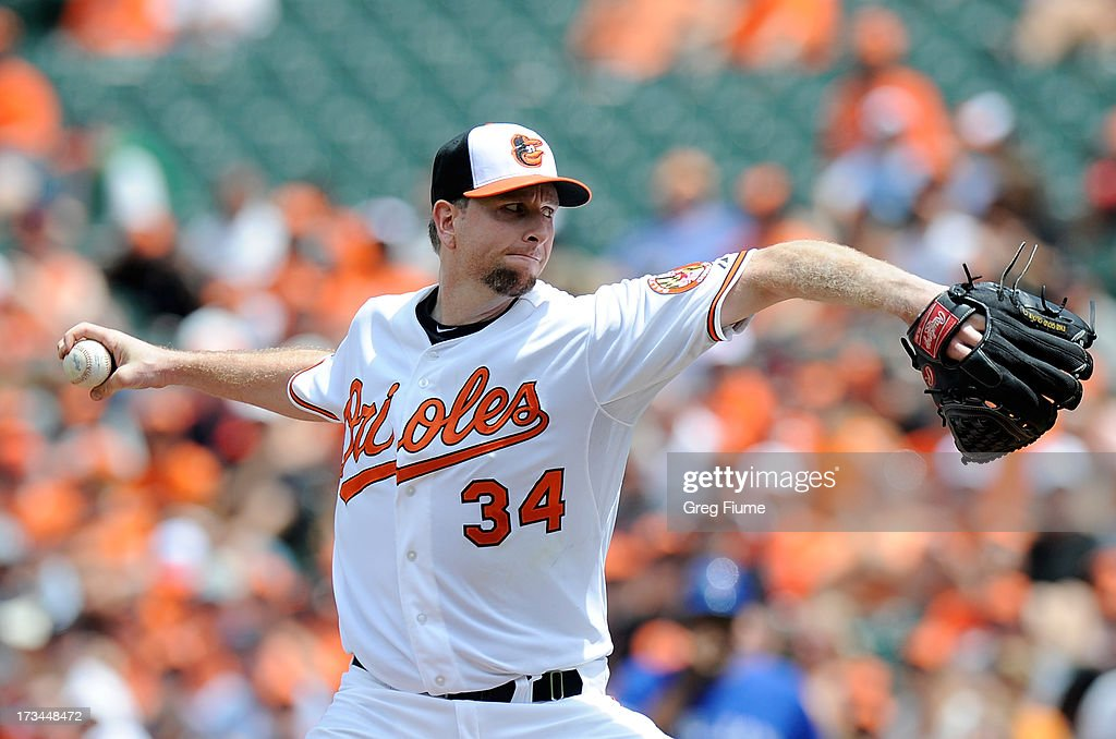 Scott Feldman #34 of the Baltimore Orioles pitches in the second inning against the Toronto Blue Jays at Oriole Park at Camden Yards on July 14, 2013 in Baltimore, Maryland.