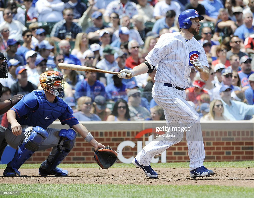 <a gi-track='captionPersonalityLinkClicked' href=/galleries/search?phrase=Scott+Feldman&family=editorial&specificpeople=540379 ng-click='$event.stopPropagation()'>Scott Feldman</a> #46 of the Chicago Cubs hits a two-run double against the New York Mets during the fourth inning on May 18, 2013 at Wrigley Field in Chicago, Illinois.