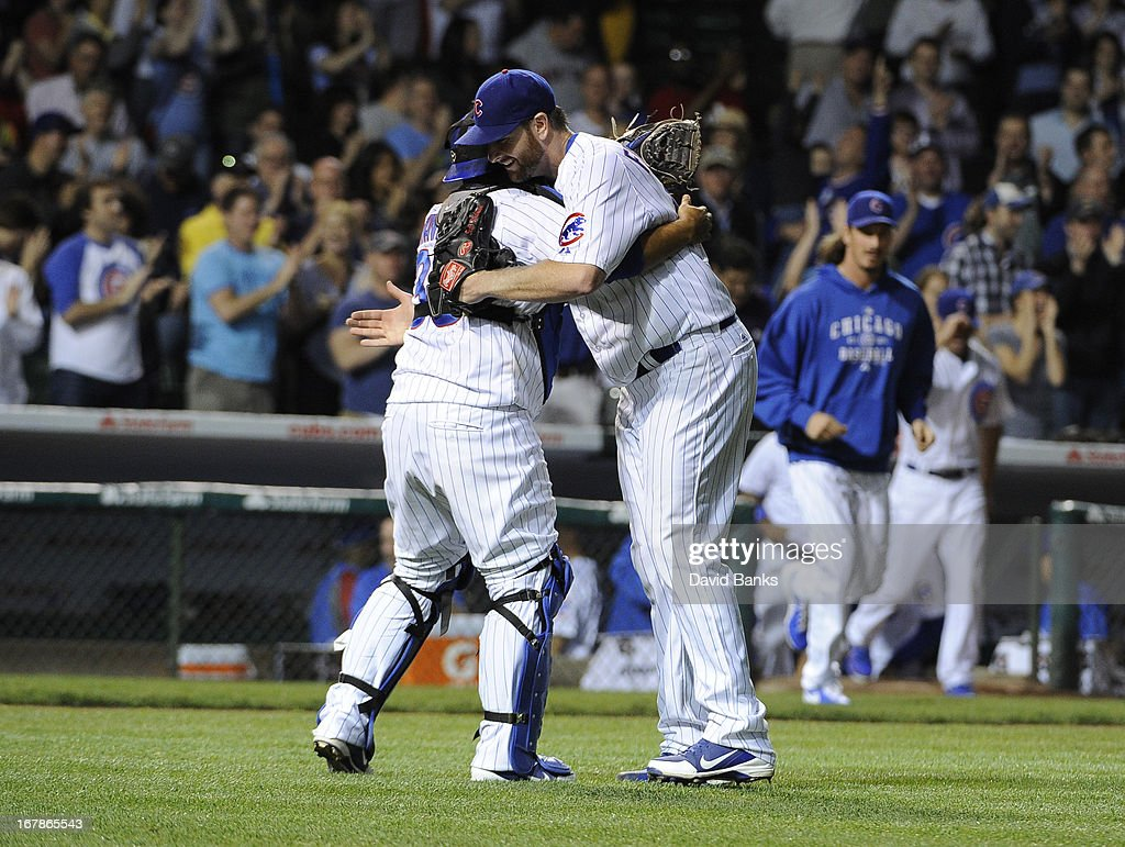 Scott Feldman #46 of the Chicago Cubs is congratulated by catcher Dioner Navarro #30 after pitching a complete game against the San Diego Padres on May 1, 2013 at Wrigley Field in Chicago, Illinois. The Chicago Cubs defeated the San Diego Padres 6-2.
