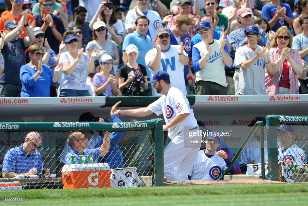 <a gi-track='captionPersonalityLinkClicked' href=/galleries/search?phrase=Scott+Feldman&family=editorial&specificpeople=540379 ng-click='$event.stopPropagation()'>Scott Feldman</a> #46 of the Chicago Cubs is greeted by his teammates after leaving the during the seventh inning against the New York Mets on May 18, 2013 at Wrigley Field in Chicago, Illinois. The Chicago Cubs defeated New York Mets 8-2.