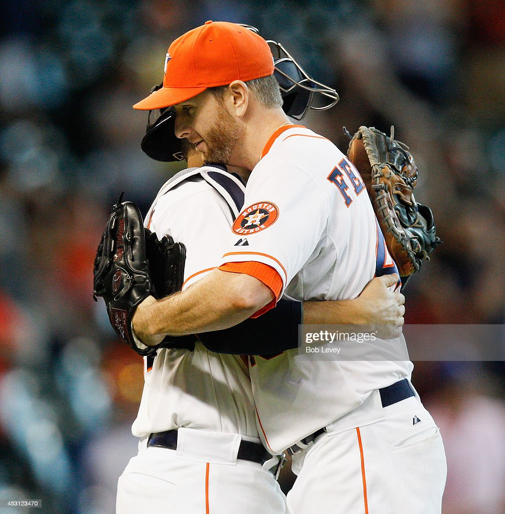 <a gi-track='captionPersonalityLinkClicked' href=/galleries/search?phrase=Scott+Feldman&family=editorial&specificpeople=540379 ng-click='$event.stopPropagation()'>Scott Feldman</a> #46 of the Houston Astros hugs catcher Jason Castro #15 afte the final out as the Houston Astros defeated the Toronto Blue Jays 6-1 at Minute Maid Park on August 3, 2014 in Houston, Texas.