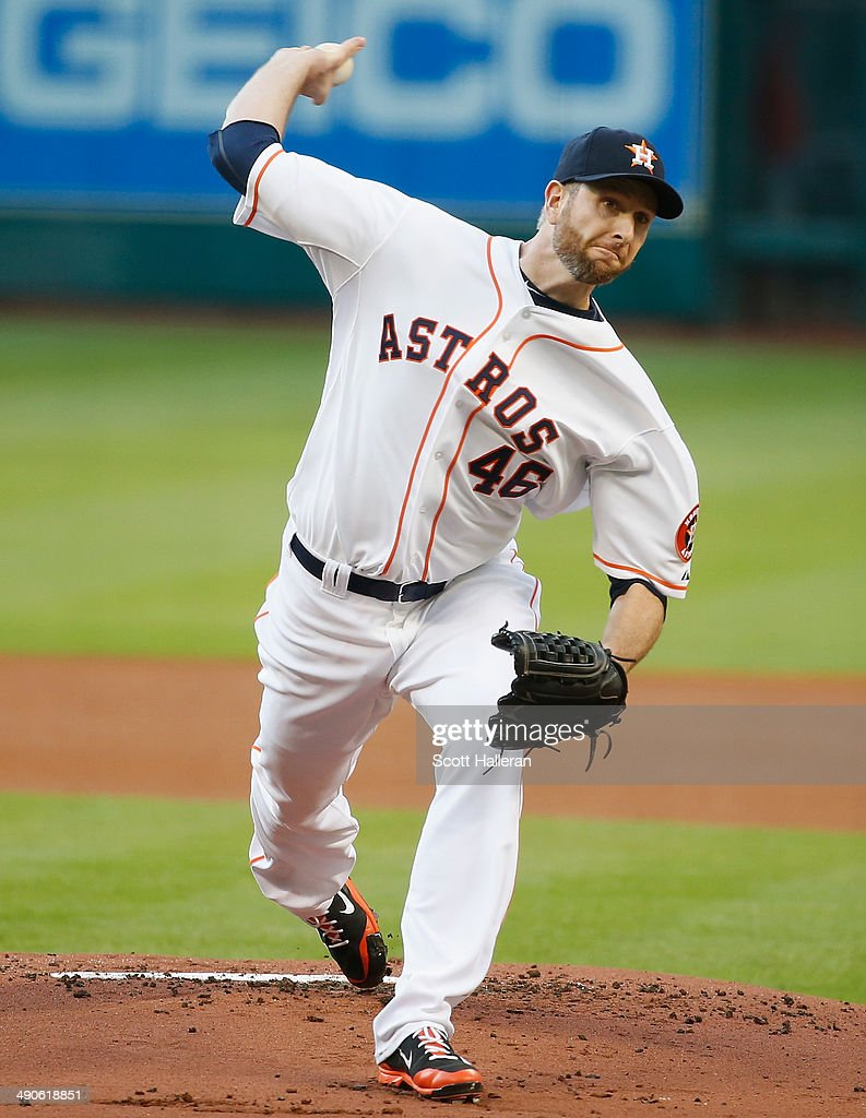 Scott Feldman #46 of the Houston Astros throws a pitch in the first inning of their game against the Texas Rangers at Minute Maid Park on May 14, 2014 in Houston, Texas.