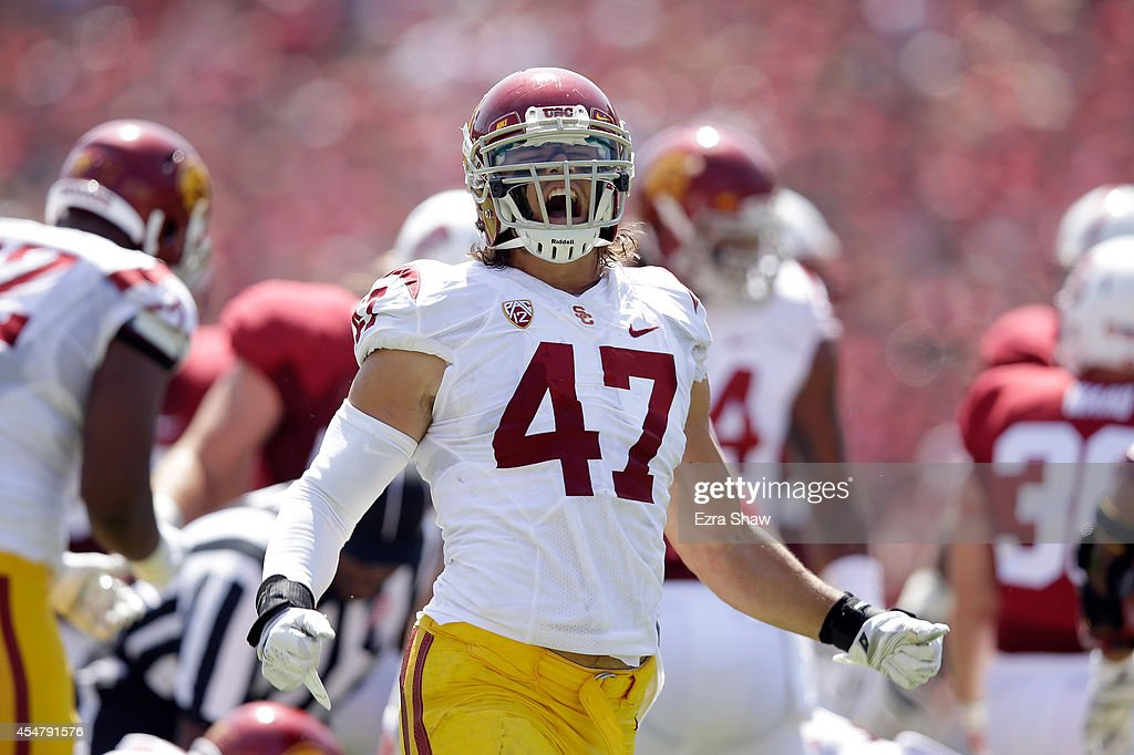 Scott Felix of the USC Trojans reacts after making a tackle against the Stanford Cardinal at Stanford Stadium on September 6 2014 in Palo Alto...