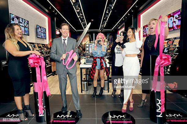 Scott Friedman and Nathalie Kristo SVP of Global Marketing and Business Development for NYX Cosmetics cut the grand opening ribbon with top beauty...