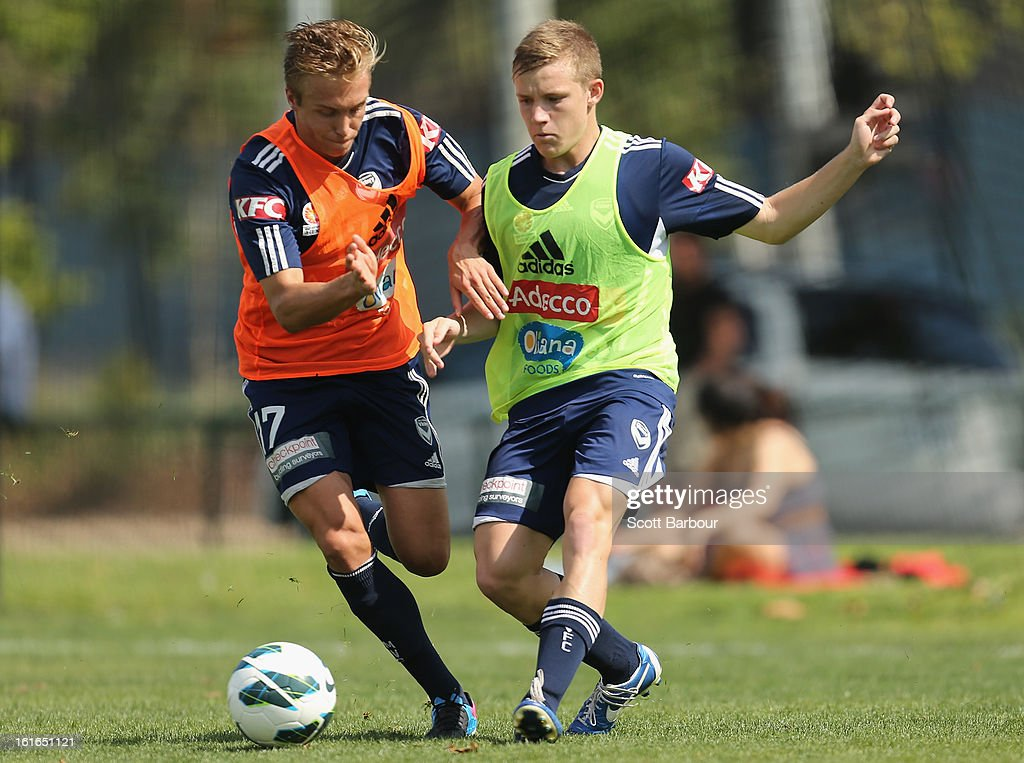 Scott Galloway (R) and James Jeggo of the Victory compete for the ball during a Melbourne Victory A-League training session at Gosch's Paddock on February 14, 2013 in Melbourne, Australia.