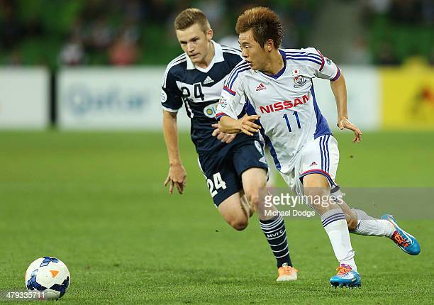 Scott Galloway of the Victory and Manabu Saito of Yokohama contest for the ball during the AFC Asian Champions League match between the Melbourne...