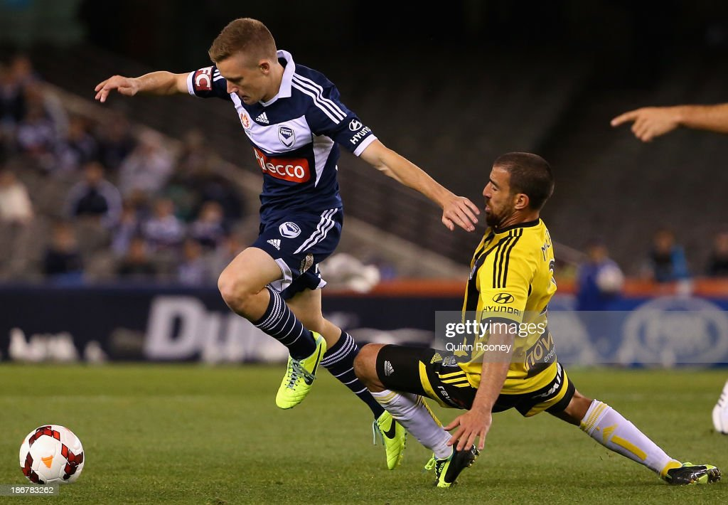 Scott Galloway of the Victory is tackled by Emmanuel Muscat of the Phoenix during the round four A-League match between Melbourne Victory and Wellington Phoneix at Etihad Stadium on November 4, 2013 in Melbourne, Australia.