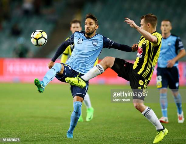 Scott Galloway of Wellington contests possesion with Milos Ninkovic of Sydney during the round two ALeague match between Sydney FC and the Wellington...