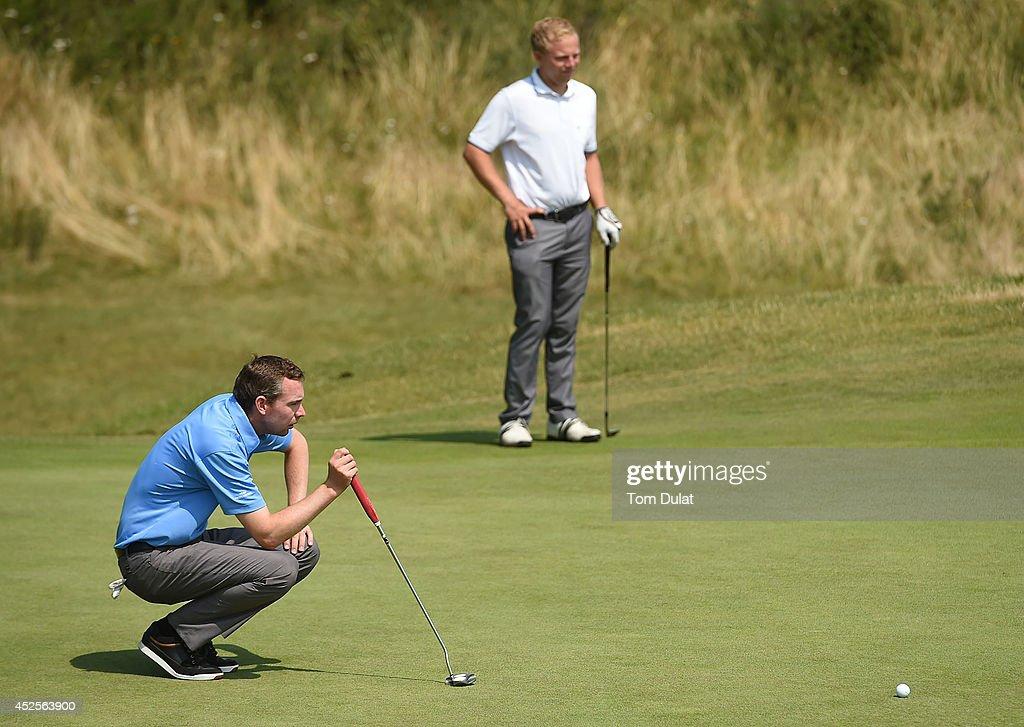 Scott Godfrey of Ferndown Golf Club lines up a putt during the Lombard Trophy West Regional Qualifier at Burnham and Berrow Golf Club on July 23, 2014 in Burnham-on-Sea, England.