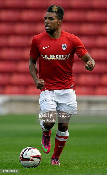 Scott Golbourne of Barnsley plays the ball during a preseason friendly against Club Brugge at Oakwell Stadium on July 12 2013 in Barnsley England