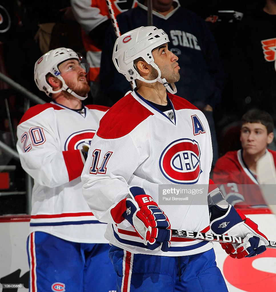 Scott Gomez and James Wisniewski of the Montreal Canadiens look up at the scoreboard during an NHL hockey game against the Philadelphia Flyers at the...