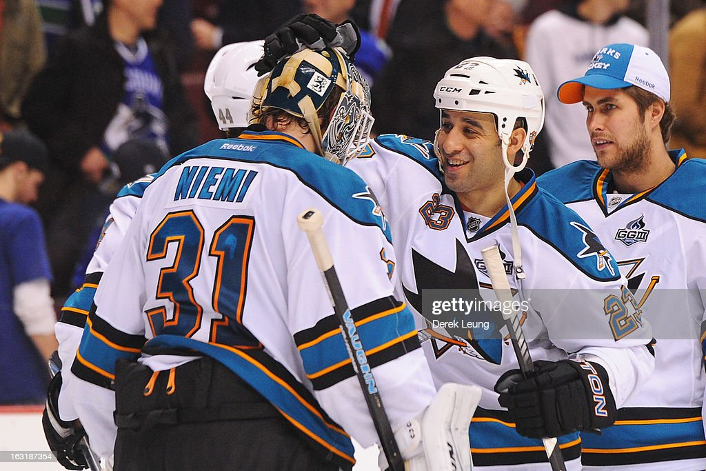 <a gi-track='captionPersonalityLinkClicked' href=/galleries/search?phrase=Scott+Gomez&family=editorial&specificpeople=201782 ng-click='$event.stopPropagation()'>Scott Gomez</a> #23 celebrates the San Jose Sharks' shoot-out victory with teammate <a gi-track='captionPersonalityLinkClicked' href=/galleries/search?phrase=Antti+Niemi&family=editorial&specificpeople=213913 ng-click='$event.stopPropagation()'>Antti Niemi</a> #31 after defeating the Vancouver Canucks during an NHL game at Rogers Arena on March 5, 2013 in Vancouver, British Columbia, Canada.