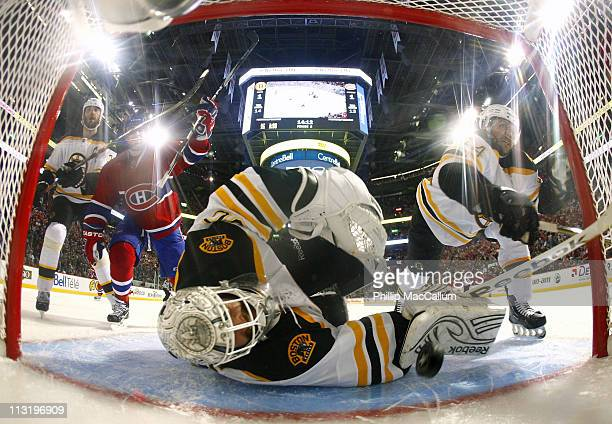Scott Gomez of the Montreal Canadiens celebrates as Tim Thomas of the Boston Bruins looks back into his net to see the puck in Game Six of the...