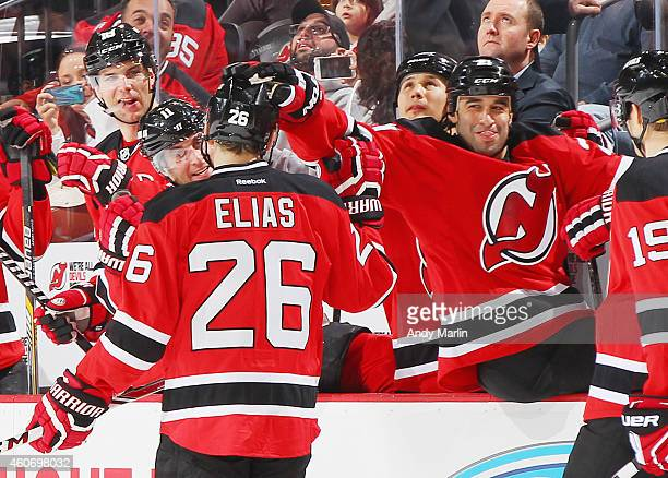 Scott Gomez of the New Jersey Devils congratulates teammate Patrik Elias after scoring a firstperiod goal against the Tampa Bay Lightning during the...