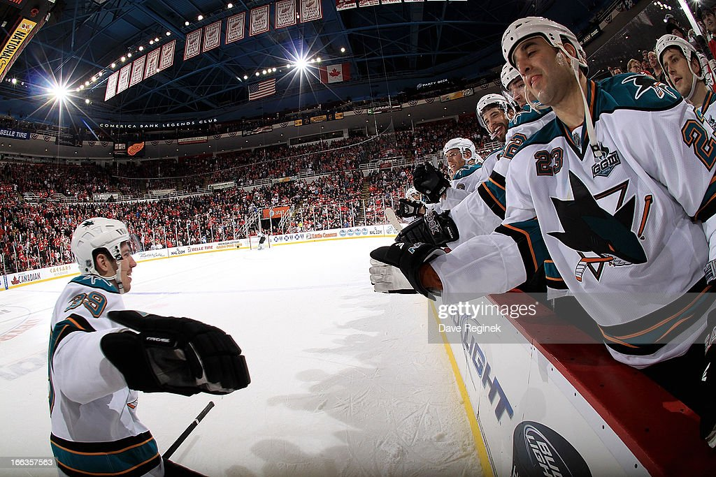 <a gi-track='captionPersonalityLinkClicked' href=/galleries/search?phrase=Scott+Gomez&family=editorial&specificpeople=201782 ng-click='$event.stopPropagation()'>Scott Gomez</a> #23 of the San Jose Sharks and other teamates on the bench congratulate <a gi-track='captionPersonalityLinkClicked' href=/galleries/search?phrase=Logan+Couture&family=editorial&specificpeople=809700 ng-click='$event.stopPropagation()'>Logan Couture</a> #39 after scoring a shoot-out goal during a NHL game against the Detroit Red Wings at Joe Louis Arena on April 11, 2013 in Detroit, Michigan. San Jose defeated Detroit 3-2 in a shoot-out