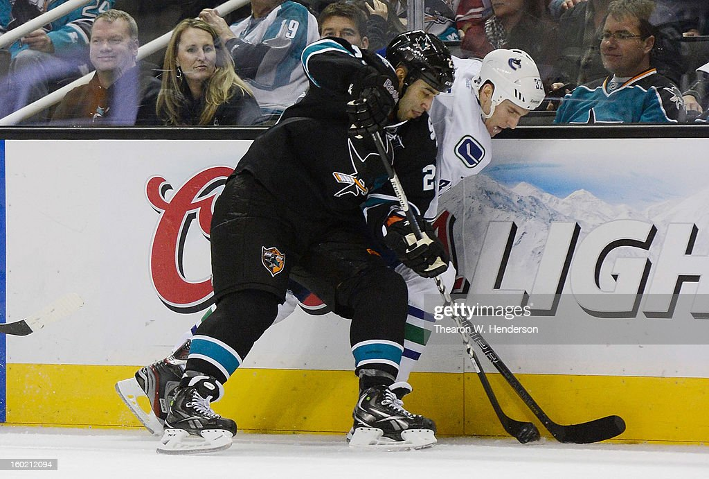 <a gi-track='captionPersonalityLinkClicked' href=/galleries/search?phrase=Scott+Gomez&family=editorial&specificpeople=201782 ng-click='$event.stopPropagation()'>Scott Gomez</a> #23 of the San Jose Sharks battles for control of the puck with Dale Weise #32 of the Vancouver Canucks in the third period of their game at HP Pavilion on January 27, 2013 in San Jose, California. The Sharks won the game 4-1.