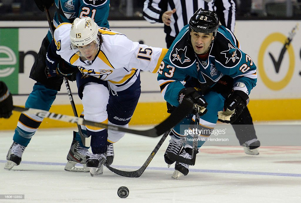 Scott Gomez #23 of the San Jose Sharks battles for control of the puck with Craig Smith #15 of the Nashville Predators at HP Pavilion on February 2, 2013 in San Jose, California.