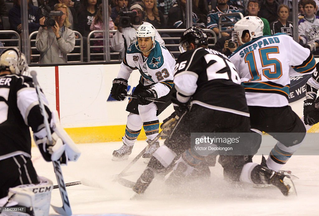 Scott Gomez #23 of the San Jose Sharks looks for the loose puck during the NHL game against the Los Angeles Kings at Staples Center on March 16, 2013 in Los Angeles, California. The Kings defeated the Sharks 5-2.