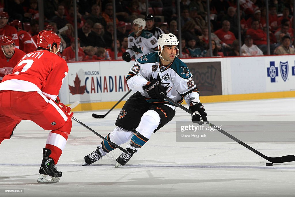 <a gi-track='captionPersonalityLinkClicked' href=/galleries/search?phrase=Scott+Gomez&family=editorial&specificpeople=201782 ng-click='$event.stopPropagation()'>Scott Gomez</a> #23 of the San Jose Sharks skates with the puck as Brendan Smith #2 of the Detroit Red Wings defends during a NHL game at Joe Louis Arena on April 11, 2013 in Detroit, Michigan.