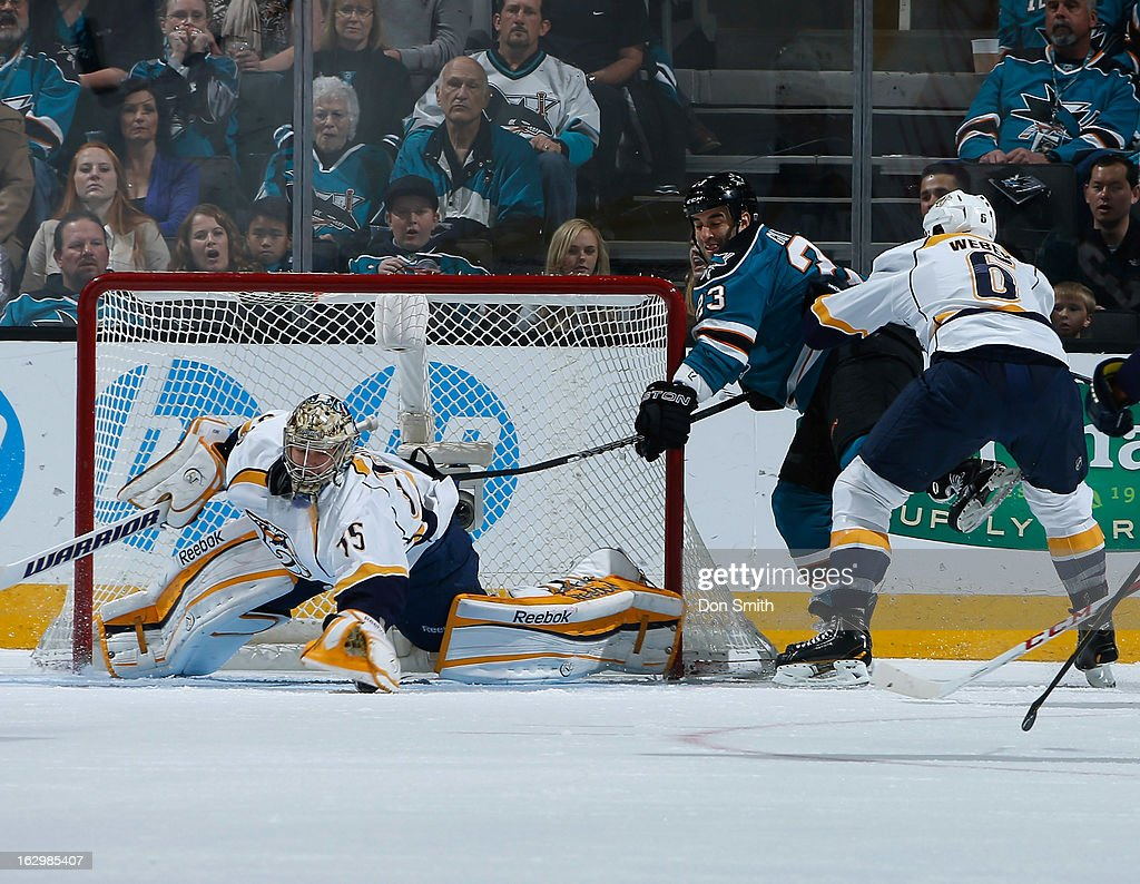 <a gi-track='captionPersonalityLinkClicked' href=/galleries/search?phrase=Scott+Gomez&family=editorial&specificpeople=201782 ng-click='$event.stopPropagation()'>Scott Gomez</a> #23 of the San Jose Sharks tries to get to the puck against <a gi-track='captionPersonalityLinkClicked' href=/galleries/search?phrase=Pekka+Rinne&family=editorial&specificpeople=2118342 ng-click='$event.stopPropagation()'>Pekka Rinne</a> #35 and <a gi-track='captionPersonalityLinkClicked' href=/galleries/search?phrase=Shea+Weber&family=editorial&specificpeople=554412 ng-click='$event.stopPropagation()'>Shea Weber</a> #6 of the Nashville Predators during an NHL game on March 2, 2013 at HP Pavilion in San Jose, California.
