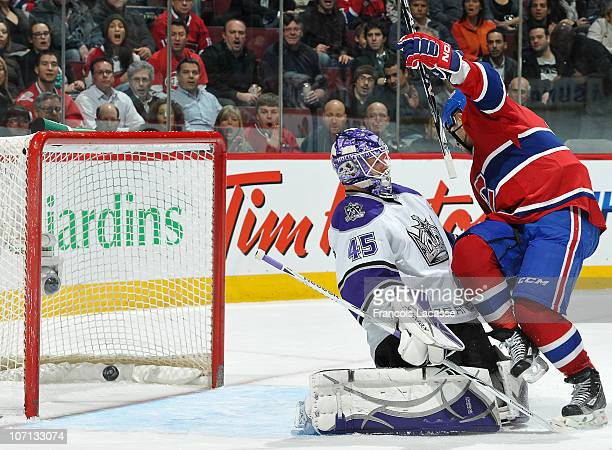 Scott Gomez the Montreal Canadiens scores his third goal of the season against Jonathan Bernier of the Los Angeles Kings during the NHL game on...
