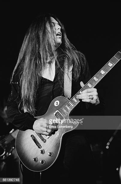 Scott Gorham of Thin Lizzy performs on stage at Colston Hall Bristol United Kingdom October 22 1976 He is playing a Gibson Les Paul Deluxe guitar