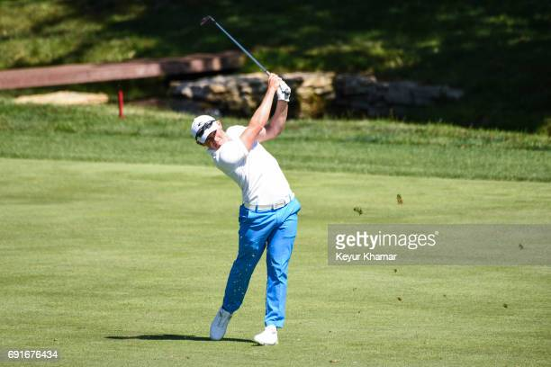 Scott Gregory of England hits a shot from the 18th hole fairway during the second round of the Memorial Tournament presented by Nationwide at...