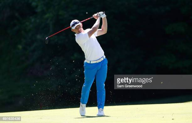Scott Gregory of England hits his second shot on the 15th hold during the second round of the Memorial Tournament at Muirfield Village Golf Club on...