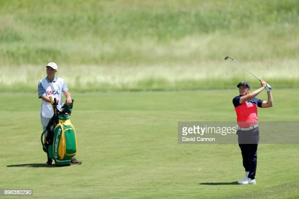 Scott Gregory of England plays his second shot on the par 4 15th hole during the first round of the 117th US Open Championship at Erin Hills on June...