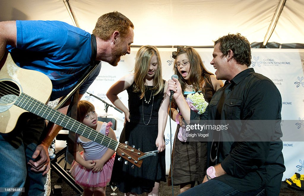Scott Grimes and Bob Guiney perform during the Global Down Syndrome Foundation 2012 fashion show at SewallBelmont House on July 19 2012 in Washington...