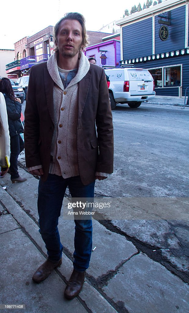 Scott Grimes, filmmaker from Los Angeles, wearing Paper Denim blazer, L.R.G. & Co. cardigan sweater, and John Varvatos boots on January 19, 2013 on the streets of Park City, Utah.